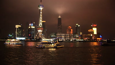 Lit Up Boat Passes Pudong, Shanghai, China, River Huangpu, Skyline At Night