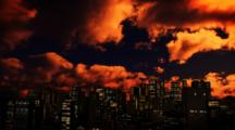 Animation, Fast Moving Orange Clouds In Night Sky Over City Skyline
