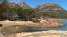 People On Shore Of Honeymoon Bay-Freycinet 02