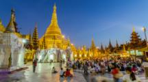 Shwedagon Pagoda In Rangoon,Myanmar, Timelapse Day Night Transition Of The Famous Landmark, Pilgrims Honor The Sacred Buddhist Site