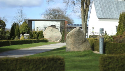 The Jelling stones in front of Jelling church glass cased to protect the stones against CO2