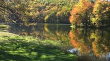 Fall Leaves And Relection On Lake