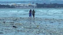Rubbish On Beach-Kids Playing