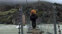 Hiking Over Foot Bridge, Auyuittuq National Park, Baffin Island