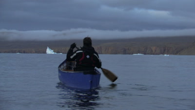 Canoeing Toward Distant Iceberg, Near Qikitarjuaq, Baffin Island