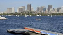 Boston MA Harbor Boats Charles River From Cambridge Towards Boston With Skyscrapers And Sculling On Water