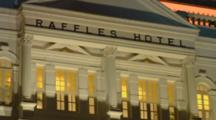 Singapore World Famous Exclusive Raffles Hotel At Night 1887 Resort With Bentley Auto In Driveway