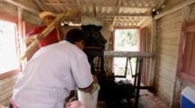 Vinales, Cuba. Farm Workers Process Juice From Sugar Cane