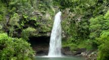 Beautiful Bouma Falls On Taveuni Island In Fiji.  Surrounded With Lush Vegetation And Wild Ginger Flowers.