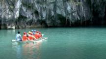 Boat Of People Enter Underground River.
