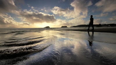 Man hiking beach at sunset,Oregon