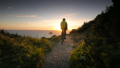 Man riding mountain bike on trail overlooking Pacific Ocean,Oregon