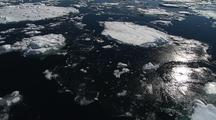 Gliding, as if flying aerial above Antarctic Ice Floes