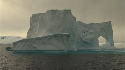 Slowly Circling Around Spectacular Hero Monolithic Antarctic Iceberg With Hole