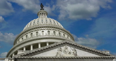 United States Capitol building with time lapse clouds