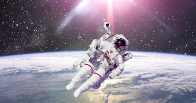 Astronaut in outer space with planet Earth in background