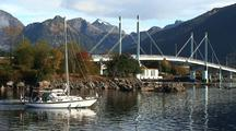 Sail Boat/Pleasure Boat Sailing In A Scenic Port/Mountains, Birds & Bridge