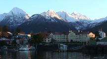 Scenic Coastal Town And Harbor.  Boats, Harbor, Historic Buildings, With Mountain Background.  Sitka, Alaska