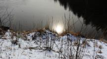 Abstract: Sun Reflection In A Pond