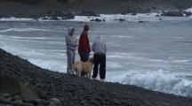 A Family Watches The Surf