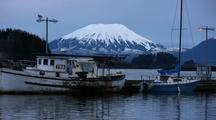 Fishing Dock At Dawn. Volcano In Background.