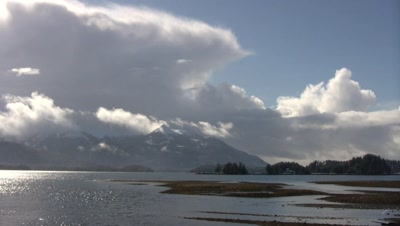 Winter Scene: Snow &  Clouds Over A Bay/Inlet