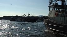 Commercial Fishermen Work On A Purse Seine Net