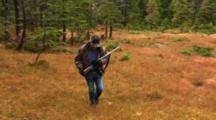 A Hunter In A Alaska Muskeg
