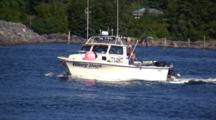Sport Fishing Boat Enters A Harbor