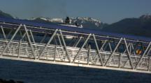 Tourists Debark From A Cruise Boat, Walk Down Ramp