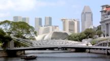 Singapore River With Tourist Boats And The Cavenagh Bridge And The Skyline Of Marina Bay