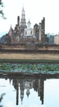 Reflections In Water, First Light Of Day Coming To Wat Mahathat At The Historical Park Time Lapse
