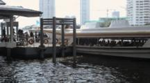 People Embark On Chao Phraya Express Tourist Boat At Taksin Saphan Pier