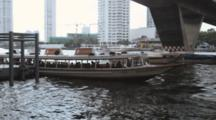 Chao Phraya Express Tourist Boat Leaving From Taksin Saphan Pier