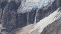 Cineflex Aerial Medium Shot Of Hanging Glacier Dramatic Icefield Landscape Push To Waterfalls And Water Cascading Down Shear Rock From Melting Glacier