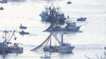 Cineflex Aerial Sitka Herring Fishery Boats With Nets Out People Busy Working Boats In Sillhouette Against Bright Water