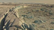 Aerial Cineflex Flight Along Face Of Glacier Crazy Moonscape Crevasses And Ice Formations
