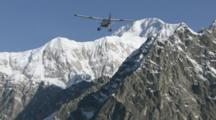 Bush Plane Seems To Float On Air As It Flies Toward Rugged Ridges In Front Of Mount Mckinley, Exits Top Of Frame. Zatzworks Cineflex Aerials Of Denali National Park, Bush Planes, Air To Air, Glaciers, National Park, Cineflex