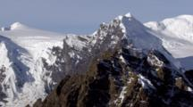 Fly By Pointed Mountain Peak In Rugged Alaska Range, Pull Back To Reveal Snow And Ice Fields Glaciers In Background. Zatzworks Cineflex Aerials Of Denali National Park, Bush Planes, Air To Air, Glaciers, National Park, Cineflex