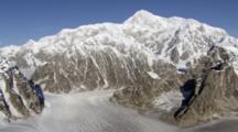 Massive Snow Covered Valley Glacier Line Of Equilibrium, Tilt Up Reveal Rocky Mountain Steep Rugged Snow Covered Mountain Peaks Couloirs Of Alaska Range. Zatzworks Cineflex Aerials Danali National Park.
