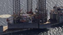 Cineflex aerial of Buccaneer jack up drilling rig in Kachemak bay alaska oil drilling arctic