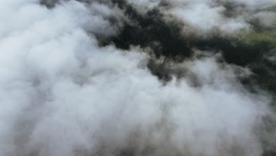 Aerial View Of Alaska Above Clouds