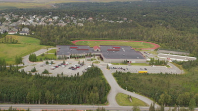 Aerial Above Anchorage Alaska Suburbs with Commercial Building,parked cars