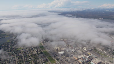 Aerial Above City of Anchorage,Alaska through clouds