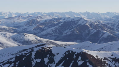 Aerial Grand Vista,Expansive Snow-Covered Mountain Range