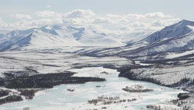 Grand Vista of Snow-Covered Mountain Range and Frozen River,Alaska