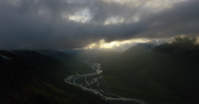 Aerial Alaska Wilderness and River with Storm Clouds Above