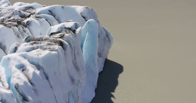 Very Low,POV Aerial over Glacier with Fissures in Ice