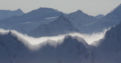Aerial Through Low Clouds,Rugged Alaska Mountain Peaks in Winter