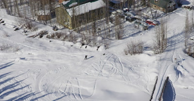 Aerial Over Alaska Village,Person Cross Country Skiing with Dog Near Houses